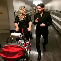 Brandon & Kelly Blackstock with their daughter River Rose Blackstock backstage