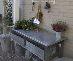 Vintage coat rack finishes a garden work area with a work bench with galvanized top