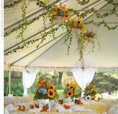 I love everything about this: sunflowers, blue accents, hanging ivy and baskets, outdoor with a tent...