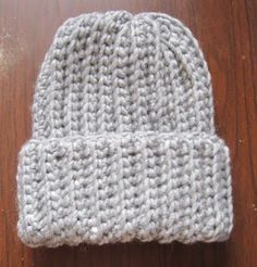 "app.12inch hight(with 3inch rolled up brim), for adult. ""it's so easy to adjust this pattern to different sizes. Just measure from the top of their head to where you want the hat to come to. I go to about the middle to bottom of the ear. Then if you want a fold up band add about 2 inches to that. So if the head measurement was 8 inches you would make a chain 10 inches long to start with."""