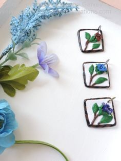 "This handmade necklace is made from polymer clay and hand painted with acrylic paint.  It will look great with many types and colours of clothing.   DESCRIPTION:  It is approximate 1-1/4"" by 1-1/4"" x 3/8"" inch and weighs 5 grams.  Each one is individually handmade so they will each be unique. Materials: Polymer clay, acrylic paint, end caps, lobster clasp, jump rings, and choice of leather, buma. Check out my website for more info by clicking on the photo.  Price is under $25.00!  Copyright."