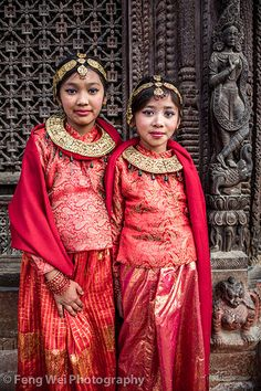 Little Brides - Portrait of two beautiful Nepalese girls of Newar community, dressed up for their very first marriage (Ihi). Shot in Durbar Square, Kathmandu, Bagmati, Nepal