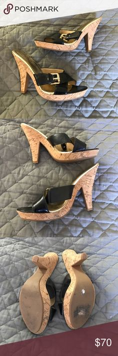 Michael Kors Buckle and Cork Heels Really cute heels from Michael Kors!  They are in good condition only worn a dozen times or so, they only have a few scuffs as seen in the photos. They have cork heel and platform, gold lining, black patent leather with gold buckle. MICHAEL Michael Kors Shoes Heels