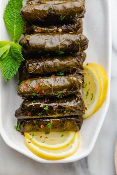 beef and rice These Lebanese Stuffed Grape Leaves (Warak Enab) are made with a spiced ground beef and rice mixture - a delicious Mediterranean dish commonly served as an appetizer! Lebanese Cuisine, Lebanese Recipes, Turkish Recipes, Arabic Recipes, Syrian Recipes, Iranian Cuisine, Vegetarian Recepies, Healthy Eating Recipes, Healthy Snacks