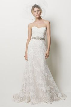 """Pasadena - ivory embroidered lace strapless dress with nude color lining and sweep train. Shown with ivory """"Rhodeo"""" belt, sold seperately"""
