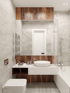 Wooden elements in the bathroom are hinted at amongst shafts of tile and marble. Wide mirrors reflect clean white ceramics, the chrome fixtures harking to the industrial. The ensuite features a full-length textured black granite wall, reminding visitors of the Stormtroopers inside.