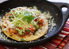 Egg yolks with tomatoes, green chiles and cheese over a crispy corn tortilla for breakfast...