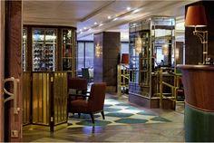 Mirrored walls and geometric rug by Martin Brudnizki Design Studio   The Rib Room, London
