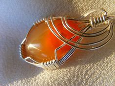 Would love to get really good at wire wrapping to create something as cool as this!