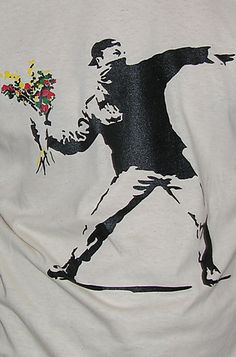 Cinema X Banksy Say It With Flowers Mens T Shirt Banksy - Say It With Flowers Iconic UK Graffiti Artist !!!!! CX London Boutique Presents.... Not On A High St Near You !!! http://www.comparestoreprices.co.uk/mens-clothes/cinema-x-banksy-say-it-with-flowers-mens-t-shirt.asp