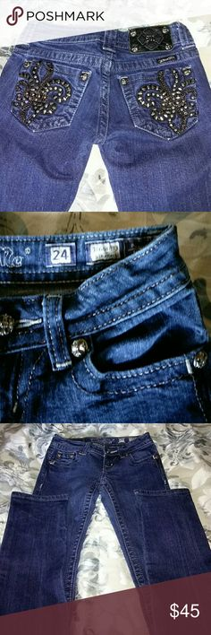 Miss Me Straight Leg Jeans Great pair of Miss Me straight leg jeans with a cool Fleur de lis pattern on back pockets! Throw on a cute  top and this awesome pair of jeans and you're all set! This is a re-posh as they are just too tight for me otherwise I'd be keeping them! Excellent condition, no stains, all stones and metalware in place. Miss Me Jeans Straight Leg