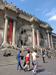 The main entrance of the Metropolitan Museum of Art, colloquially known as the Met. Located on 5th Avenue in Manhattan, New York City, the Met is the largest art museum in the United States of America. It`s a gorgeous, sunny day in the city. Some visitors climb the steps towards the front door while others sit on the stairs, enjoying the beautiful afternoon. A group of cool young black men walks by the museum. One man`s pants are sagging, a fashion in which a person`s pants sag below the…
