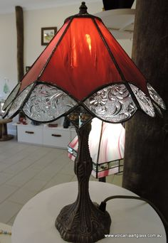 Red and florial leadlight lamp. $295au