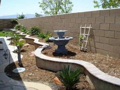 Fountain Statue For Gravel Backyard Landscaping Ideas