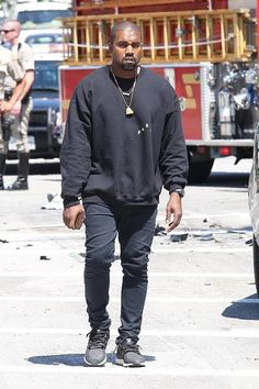 Kanye West wearing Adidas Ultra Boost Sneakers and The Life of Pablo Paris Crewneck Sweatshirt
