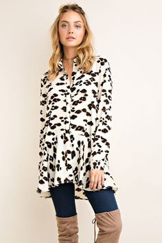 This Leopard Print Top is so perfect! It features a cream Leopard print high low style button down shirt with a ruffled hem. This top is perfect for work and play! Button closure sleeve cuff. Non-sheer. Woven. Lightweight. 95%POLYESTER 5%SPANDEX Small fits size 0-4 Medium fits size 4-6 Large fits size 8-10