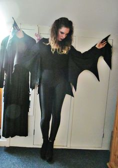 DIY Bat Costume- this would be better with bat-like makeup (maybe do it similar to cat face paint) and a headband with bat ears.