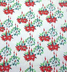 vintage Christmas wrapping paper with candles and poinsettias