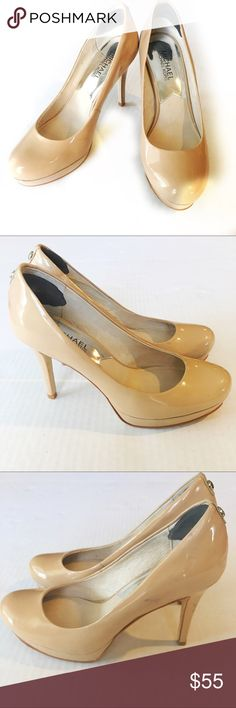 Michael Kors Ionna nude pumps Nude patent leather pumps from Michael Kors. Perfect with any outfit! Dress up or down. Some scuffs, near the back of shoe and on heel. Not noticeable when wearing. Michael Kors Shoes Heels