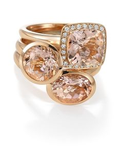 In 18k Rose Gold, this Ring features a Morganite Stone surrounded with Diamonds.