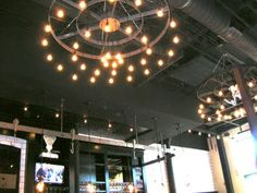 Custom Light fixture at The Rail in Akron, new burger joint that opened last fall. Great food and you can cozy up to one of the best made bars I have seen in a long time, all concrete and rebar.... one word Awesome