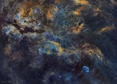 """Central Cygnus Skyscape"" - In cosmic brush strokes of glowing hydrogen gas, this beautiful skyscape unfolds across the plane of our Milky Way Galaxy and the center of the northern constellation Cygnus the Swan."