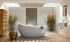 idees deco salle de bain avec grande baignoire blanche et deco zen