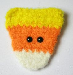 Candy Corn Brooch. Those beady little eyes remind me of Abby :(