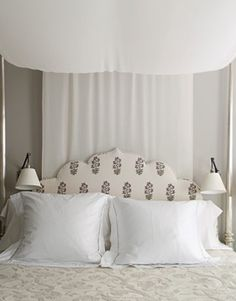 Canopied in billowing 18th-century Syrian embroidery, the master bedroom's handmade Indian silver bed is the apartment's grandest romantic flourish. Its headboard is upholstered in Peter Dunham's Udaipur.