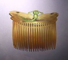 unsigned French art nouveau dragonfly comb, whose wings had a triangular silver inlay. It was priced at $1200, made of finely carved horn, and attributed to Elizabeth Bonte.