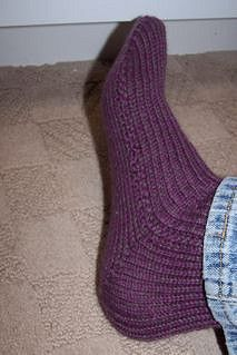 This pattern is written out step by step and has many photos to help you out. Even a beginner machine knitter can knit these socks. The pattern is written for the single bed mid-guage 6.5 machine, but there are notes for adjusting the pattern for the standard 4.5 machine. Happy knitting!! The website link is http://hermanhillsfarm.com/index.php/machine-knit-sock/