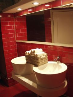 Thick White Vessel Sinks With Red Tiled Floors And Walls