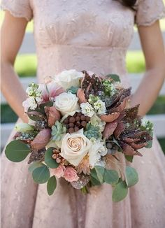 love this bouquet and all the colors -- could work if we did a purple scheme, or mint/jade scheme of bridesmaid dresses. works with joshs love of incorporating fig too. rose gold accessories still play.