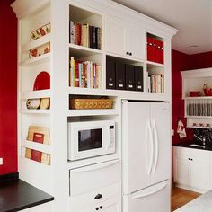 LOVE this red, white, and black kitchen and the imaginative use of space around the refrigerator.  Very cool!