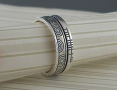 Celtic Spiral Wedding Ring | Ogham Rail edge says faith.Made in Ireland by Boru