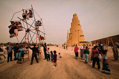 Children's games beneath the magnificent spiral minaret in Samarra, 1100 years old. © Michael Yamashita