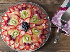 Sugar Cookie Crust Fruit Pizza.... My mom has made this for years!  Perfect Summertime dessert!