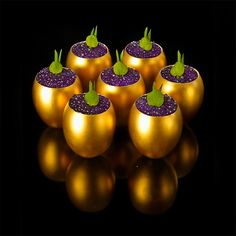 Golden Goose Eggs with foie gras mousse, rhubarb crisps and chilli chocolate chips, topped with violet caviar and micro watercress bunnies | Bubble Food