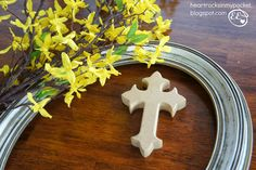Making an Easter Wreath with an old frame, unfinished cross and forsythia sprigs