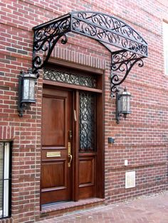 Custom Wrought Iron Glass Canopy and Matching Transom and Window Grilles - beautiful.