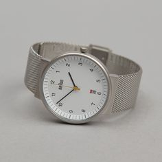 Braun watch. I like the white face and metal band!