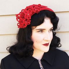 Gone with the wind it is a late 1940s scarlet ohara of a hat, here before anywhere else.. has stunning matching fabric flowers with rhinestone centers.  * Vintage 1940s * Cap style * Scarlet in color * velvety texture in red fabric * fabric flowers, includes one leaf * all rhinestones present in center flowers * original small hat pin in back  Label: Noreen Fashions  Condition: Pristine  Flaws: Beautiful condition. Price reflects condition.  Size: 22, has flexible wiring to fit many head…