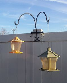 Great Idea To Hang Flower Baskets Or Bird Feeders On Fence