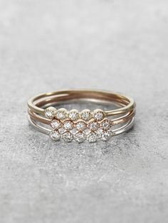 Cast in Solid 14K Gold, with a romantic row of 5 sparkling Diamond gems, these beautiful slim stacking rings are delicate and precious. Sold individually, but made to be collected and layered. Handcra