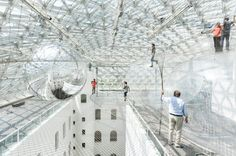 Artist and architect Tomás Saraceno(you know, the Cloud Cities guy) created a massive layered installation that's suspended more than 25 meters (approx. 82 feet) in the air of the Kunstsammlung Nordrhein-Westfalen museum in Düsseldorf, Germany.