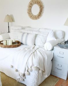 Sofa-Style Daybeds - love how Annie took a queen mattress, stuffed the back cushions from an Ikea slipcover and used bolster pillows to create a huge queen sofa for their family room.