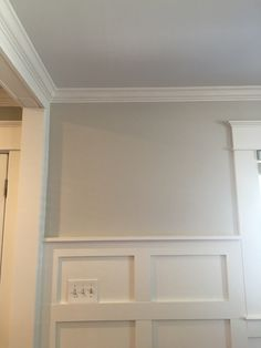 Benjamin Moore Paint:  Ceiling-25% Ocean Air  Wall-50% Revere Pewter Moulding, Board and Baton- White Dove
