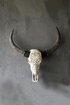 Skull carving by young artisans in village workshops. I actually like this. It'd be cool to to paint the pattern bright colors.