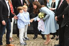 Kate received a bouquet from two very smartly dressed boys in matching outfits as she arri...