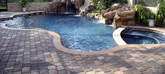 Brick pavers come in a variety of colors. Earth tones are popular, but many pool decks are surfaced with cooler shades.